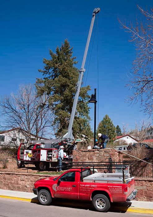 Barnhart Pump Co. water well pump company Colorado red truck service call