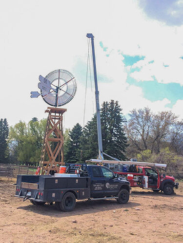 Barnhart Pump Co. water well pump company Colorado blue truck windmill