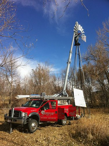 Barnhart Pump Co. water well pump company Colorado red truck windmill